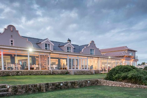 This elegantly gabled Lodge is built only metres above the wide-stretched beaches of Saldanha Bay; a tranquil South African fishing village in the Western Cape